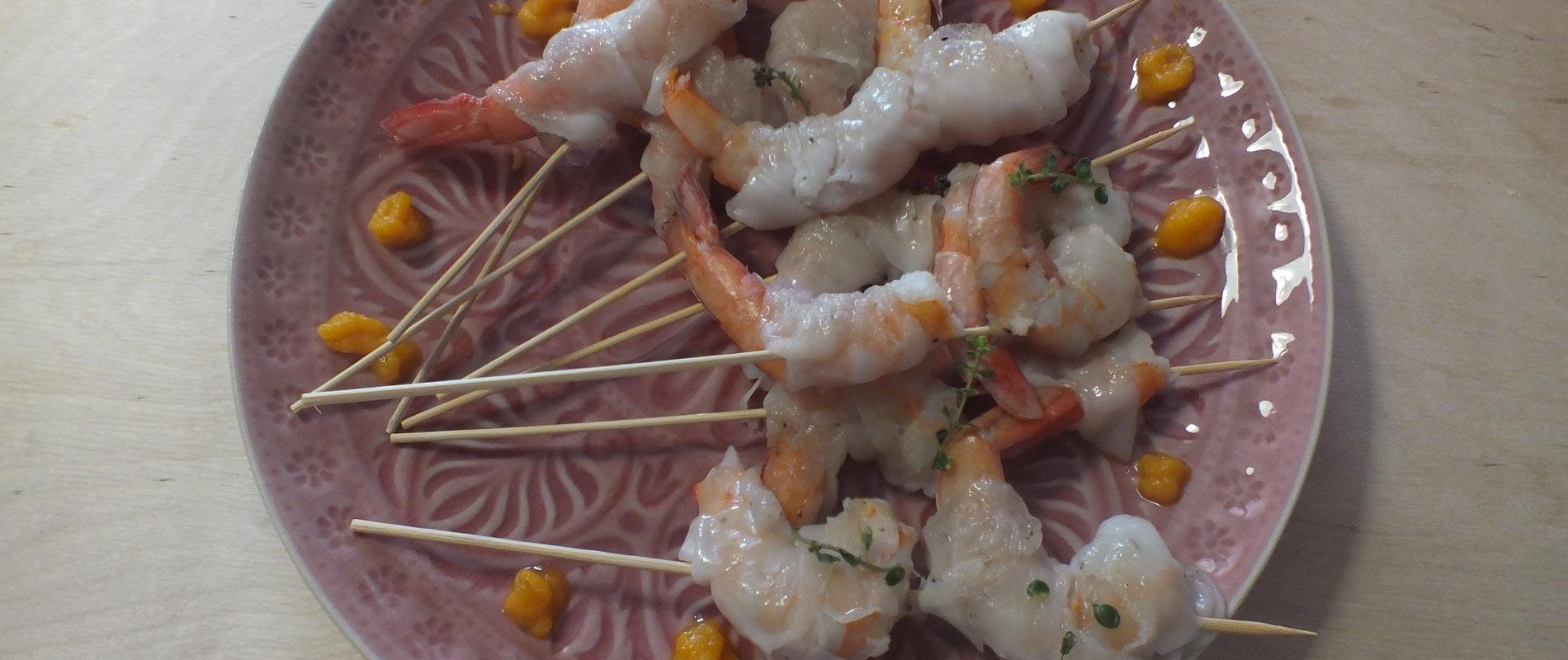 Code di gambero con lardo di cinta senese e salsa alle carote